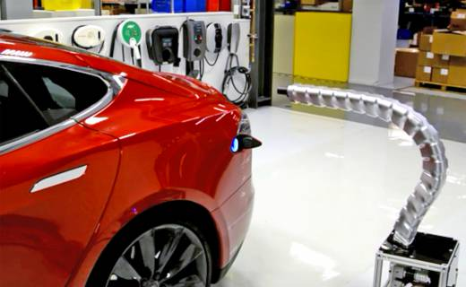 tesla robotic snake charging arm electric vehicles